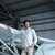 handsome young man standing near smal airplane stock photo © deandrobot