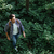 vista · lateral · homem · mochila · floresta · sorridente · camisas - foto stock © deandrobot