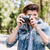 happy casual man making photo on camera stock photo © deandrobot