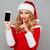 woman in santa claus dress holding blank screen mobile phone stock photo © deandrobot