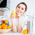 beautiful smiling woman drinking fresh orange juice stock photo © deandrobot