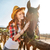 smiling woman cowgirl taking care and hugging her horse stock photo © deandrobot