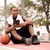 cheerful african basketball player sitting inpark and holding ta stock photo © deandrobot