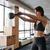 fitnessz · kereszt · fitt · nő · tart · kettlebell - stock fotó © deandrobot