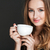 smiling attractive young woman holding white cup and drinking coffee stock photo © deandrobot