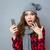 surpreendido · mulher · jovem · telefone · foto · isolado - foto stock © deandrobot