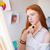 thoughtful pretty young redhead woman artist thinking and making sketches stock photo © deandrobot