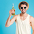 happy man in hat and sunglasses holding bottle of beer stock photo © deandrobot