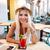 mulher · jovem · sessão · restaurante · atraente · telefone - foto stock © deandrobot