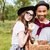 happy young couple with basket of drinks food and flowers stock photo © deandrobot