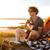 笑みを浮かべて · 若い男 · 座って · テント · 演奏 - ストックフォト © deandrobot