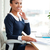 Vertical image of young african business woman on armchair stock photo © deandrobot