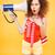vertical image of shocked bright model listening megaphone stock photo © deandrobot