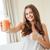 mulher · vidro · suco · de · laranja · polegar - foto stock © deandrobot
