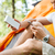 jonge · man · mobiele · telefoon · bos · boomstam · telefoon - stockfoto © deandrobot