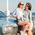 two smiling women standing together near vintage car stock photo © deandrobot
