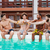 group of men drinking beer and relaxing in swimming pool stock photo © deandrobot