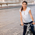 portrait of a woman riding bicycle in the city street stock photo © deandrobot