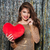 happy beautiful young woman standing and holding red heart stock photo © deandrobot