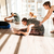 group of people stretching and practicing yoga with trainer stock photo © deandrobot