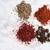 anise white pepper chilli pepper flakes and saffron heaps stock photo © deandrobot