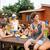 gelukkig · vrienden · park · barbecue · groep - stockfoto © deandrobot