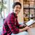 feliz · barbado · joven · pie · lectura · biblioteca - foto stock © deandrobot