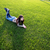 portrait of a happy woman lying on green grass stock photo © deandrobot