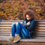 sad woman sitting on the bench in autumn park stock photo © deandrobot