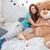 pretty smiling girl hugging big plush bear at home stock photo © deandrobot