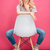 verwonderd · blonde · vrouw · vergadering · stoel · roze · meisje - stockfoto © deandrobot
