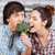 Couple biting broccoli together in the kitchen stock photo © deandrobot