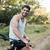 adam · bisiklet · orman · yol · bakıyor · kamera - stok fotoğraf © deandrobot