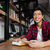 feliz · asiático · masculino · estudante · leitura · livro - foto stock © deandrobot