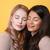 güzel · genç · iki · kadınlar · ayakta · sarı - stok fotoğraf © deandrobot