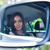 woman looking at her reflection in a car mirror stock photo © deandrobot