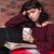 attrative pensive young woman reading book and drinking tea stock photo © deandrobot
