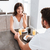 couple having breakfast and holding hands at home stock photo © deandrobot