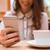 fiatal · nők · okostelefon · kávé · kávézó · technológia · életstílus - stock fotó © deandrobot