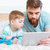 dad and son using tablet together at home stock photo © deandrobot