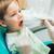 fiú · fogorvos · fogászati · eljárás · megelőzés · szék - stock fotó © deandrobot