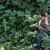 вид · сбоку · человека · рюкзак · лес · улыбаясь · рубашку - Сток-фото © deandrobot
