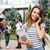 happy woman student standing and talking on cell phone outdoors stock photo © deandrobot