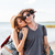 couple with backpacks standing and kissing on the beach stock photo © deandrobot