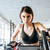 beautiful young sportswoman training on stationary bike in gym stock photo © deandrobot