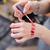 mãos · maquiador · batom · vermelho · mulher · lábios - foto stock © deandrobot