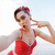 happy pretty pinup girl in red swimsuit showing victory sign stock photo © deandrobot