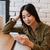 glimlachend · jonge · asian · vrouw · praten · telefoon - stockfoto © deandrobot