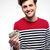 smiling man holding money over gray background stock photo © deandrobot