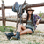 smiling happy cowgirl sitting and resting at the ranch fence stock photo © deandrobot